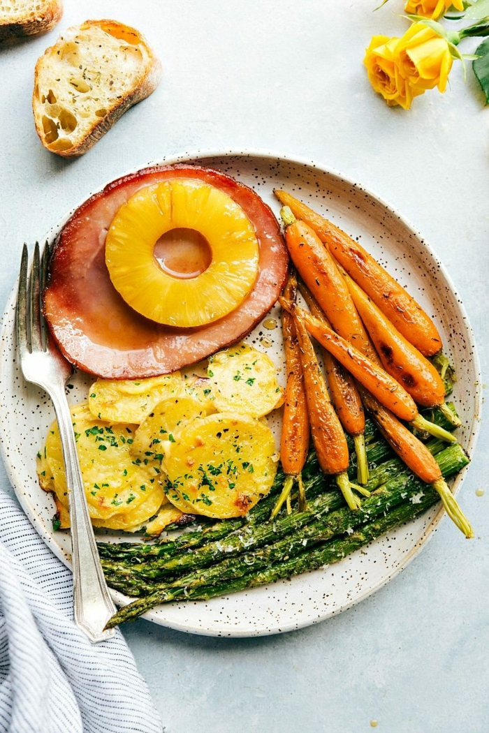 baked ham slice with pineapple, easter dishes, roasted carrots and asparagus, creamy potatoes on the side