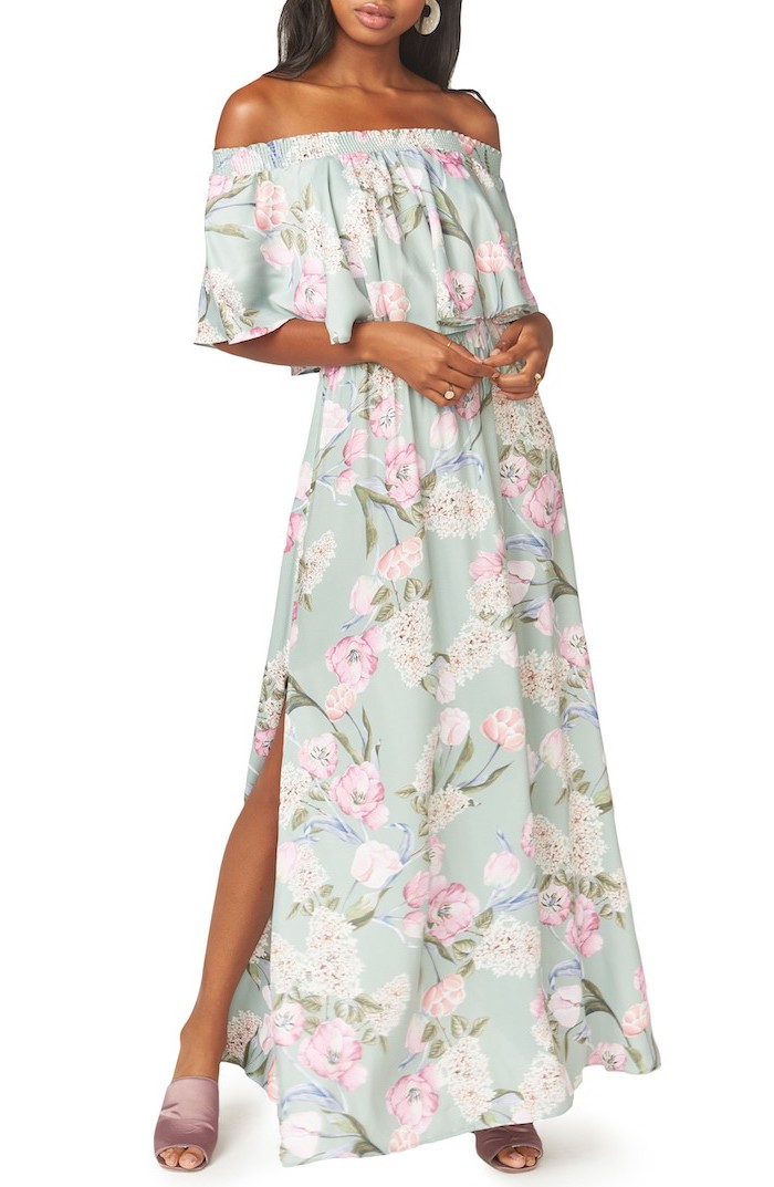 long blue dress with floral print, worn by brunette woman, easter dresses for women, white background