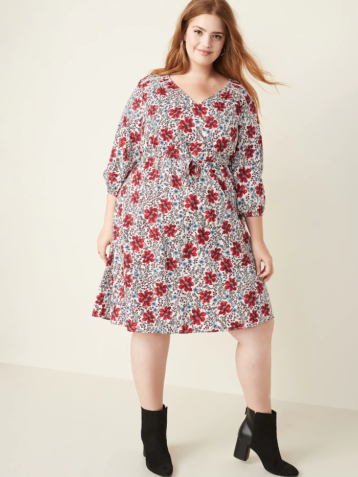 woman with red hair, wearing a white dress with red flowers print, easter dresses for women, black velvet boots