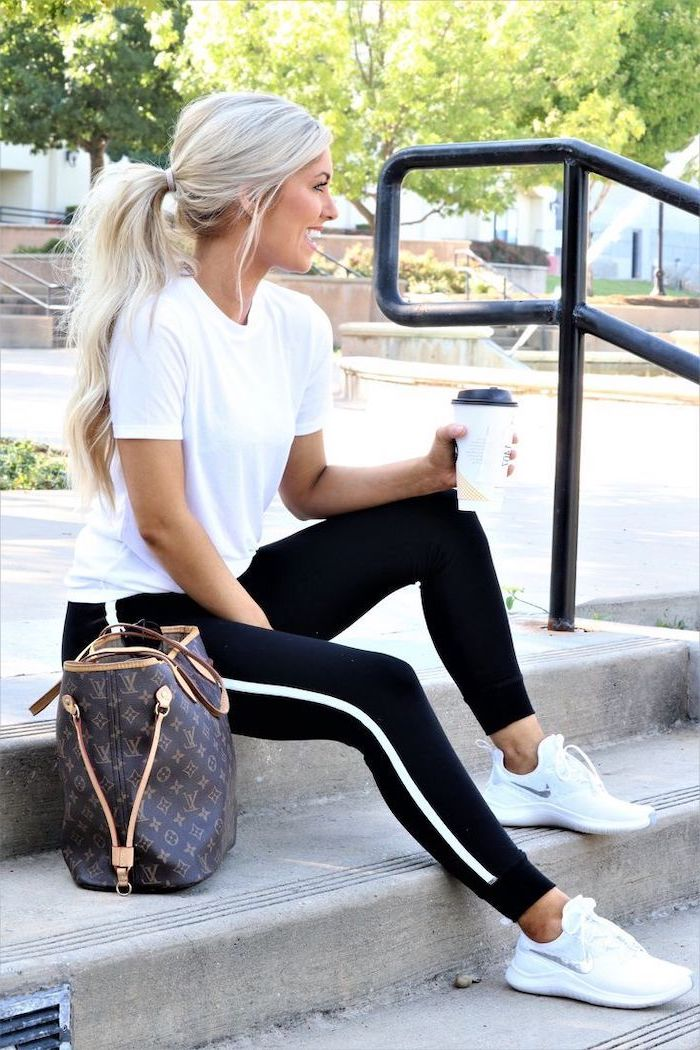 blonde woman sitting on a staircase, wearing black trousers and white t shirt, outfit ideas for school, white nike sneakers