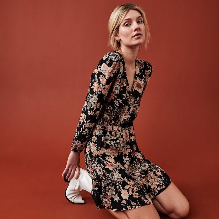 blonde woman wearing a dress with floral print, white leather boots, easter dresses for women, red background
