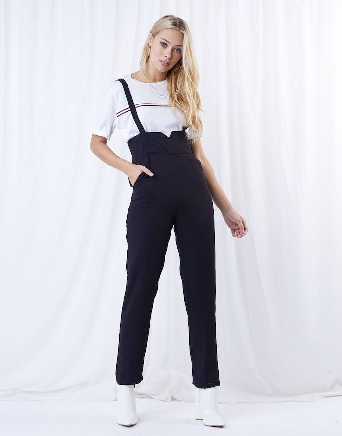 blonde woman wearing black overalls, white t shirt and leather boots, outfit ideas for school, white background