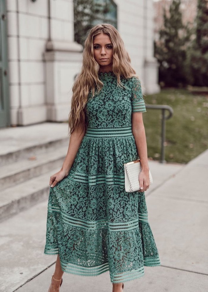 woman with long blonde wavy hair, wearing a green lace dress, easter dresses for girls, standing on sidewalk