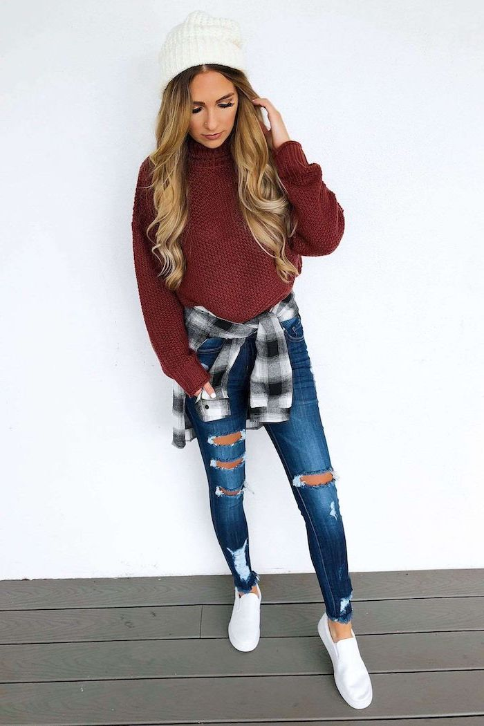 blonde woman wearing jeans, red sweater and plaid shirt around her waist, cute fall outfits, white beanie and sneakers