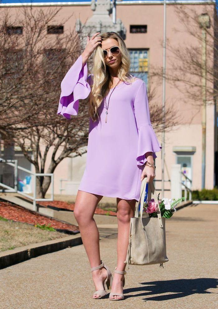 woman with long blonde wavy hair, standing on sidewalk, wearig purple dress with long sleeves, sundresses for women, nude heels