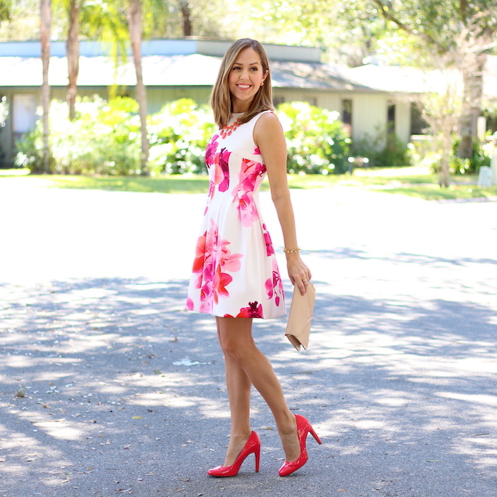 woman walking down the street, wearing white dress with pink flowers print, sundresses for women, red heels