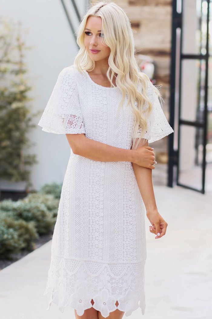 flowy dresses, woman with long blonde wavy hair, wearing white lace dress with short sleeves
