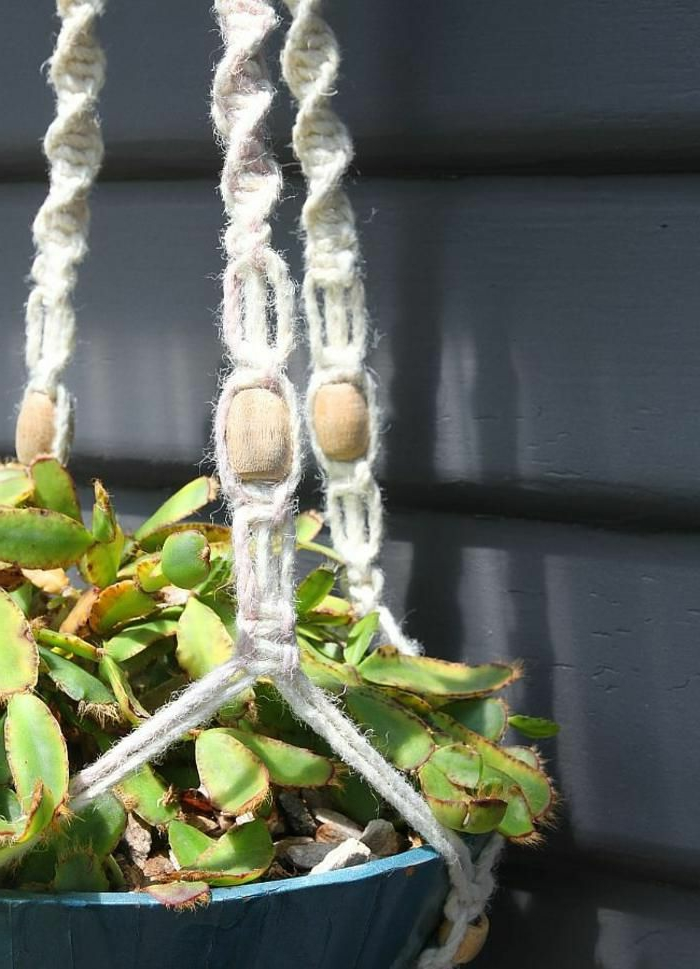 white macrame with wooden beads, blue ceramic pot hanging from the ceiling, how to macrame