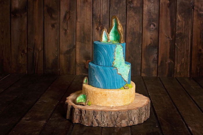 three tier cake, covered with blue marble and gold fondant, geo cake, decorated with turquoise rock candy