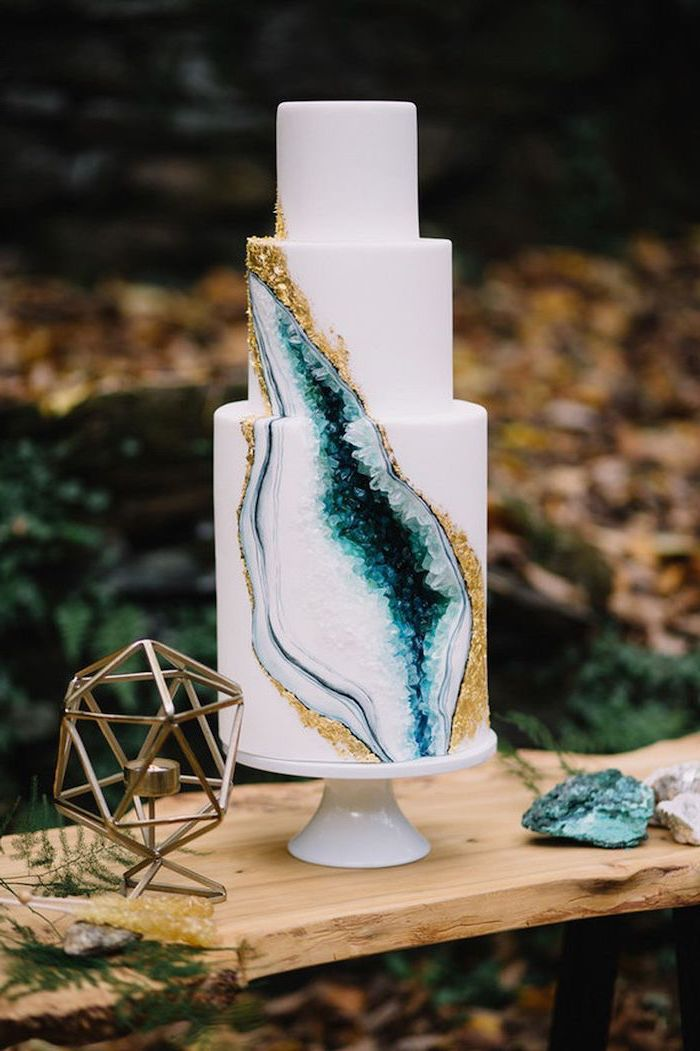 three tier cake, covered in white fondant, geo cake, decorated with rock candy, painted in blue turquoise and white