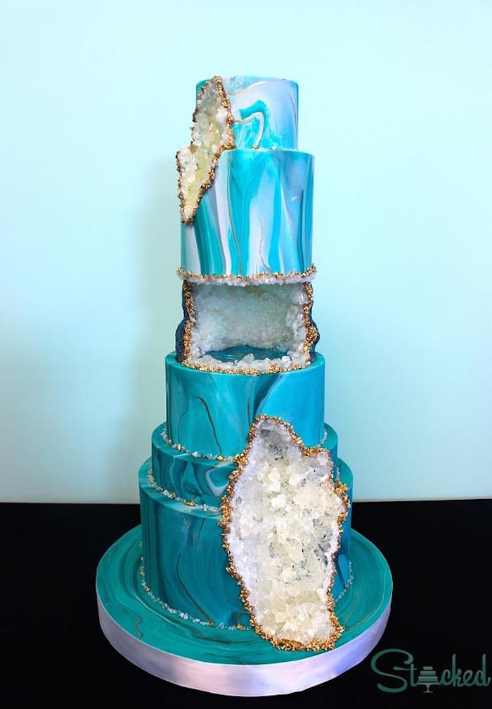 six tier cake, covered with blue and white fondant, geo cake, decorated with white rock candy