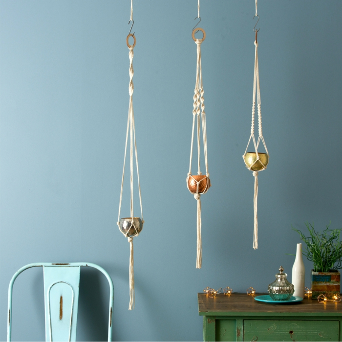 three small pots hanging from the ceiling, how to make a hanging planter, blue metal chair and blue wall in the background