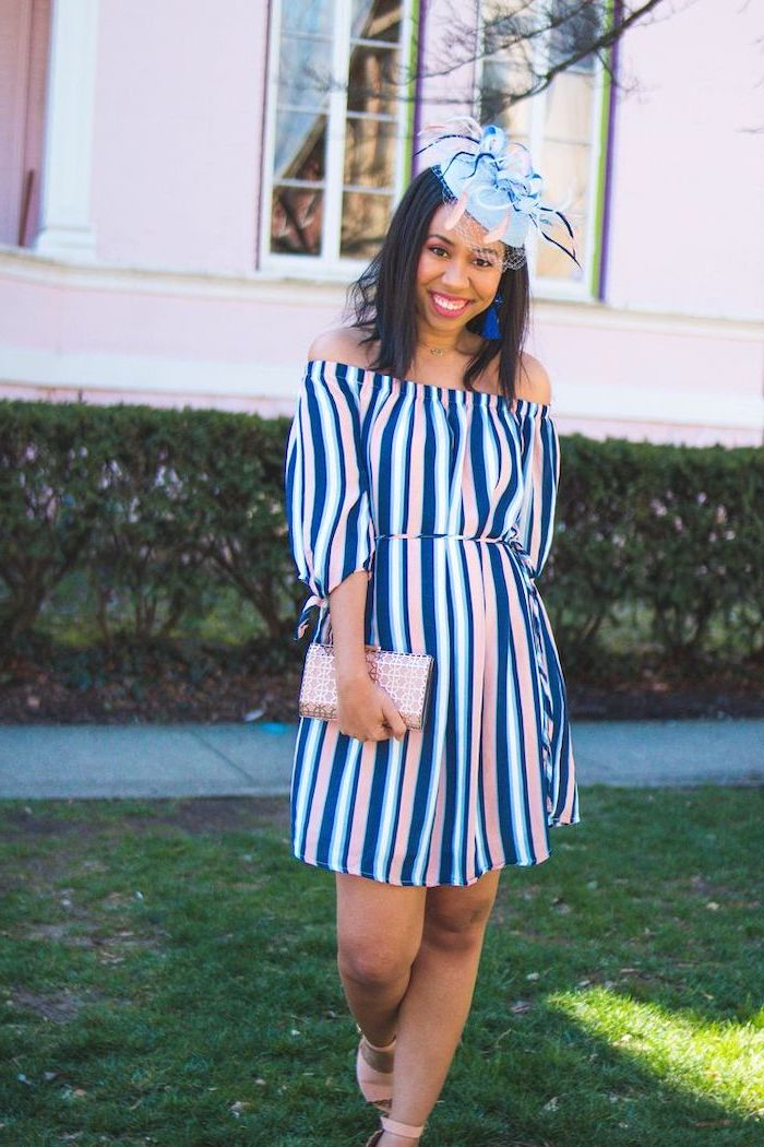 brunette woman with a hat on her head, wearing blue white and pink striped dress, flowy dresses, pink heels