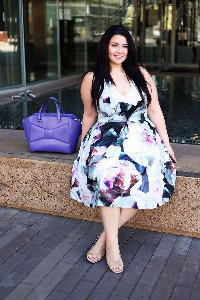 woman with long black hair, wearing a dress with floral print, flowy dresses, purple leather bag next to her