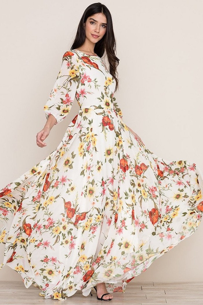 woman with long black hair, wearing a long white dress with floral print, black sandals, sunflower dress