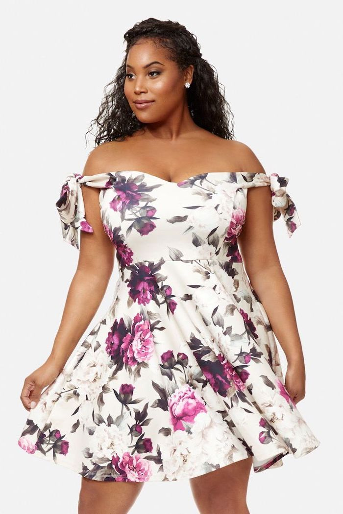 woman with curly black hair, wearing white dress with floral print and bare shoulders, easter outfits, white background