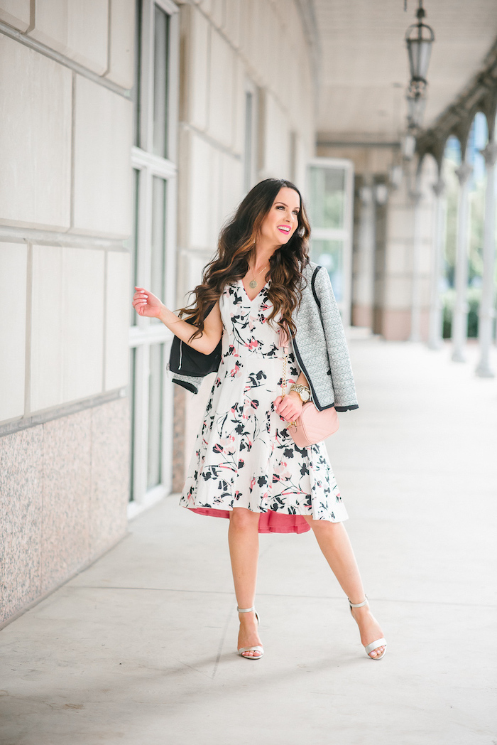 woman with brown long wavy hair, wearing white dress with floral print, grey blazer, easter outfits