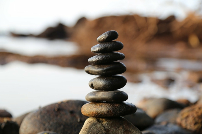 spa holidays, a bunch of rocks, stacked together on top of larger rocks, blurred background