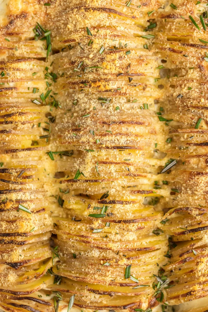 garlic and herb scalloped potatoes, easter dinner ideas, sliced and arranged in a casserole dish