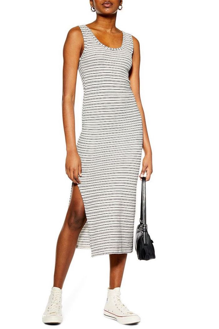 woman wearing white and black striped dress, white high top converse shoes, outfit ideas for school, black bag
