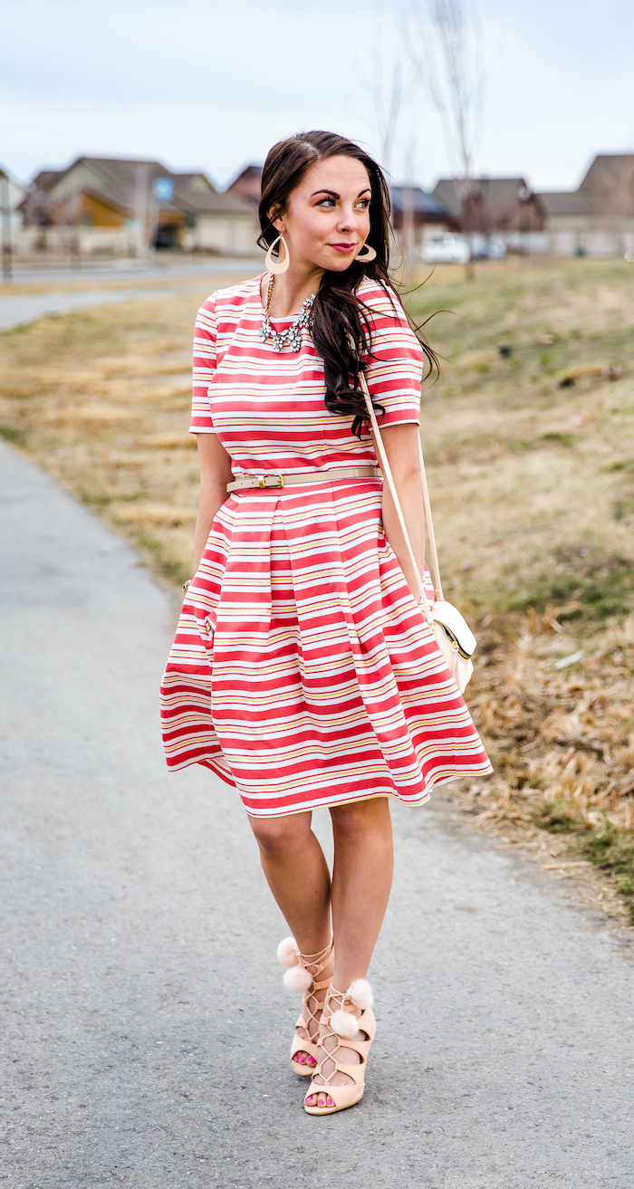 woman with brown wavy hair, wearing white and red striped dress, easter outfit, nude heels