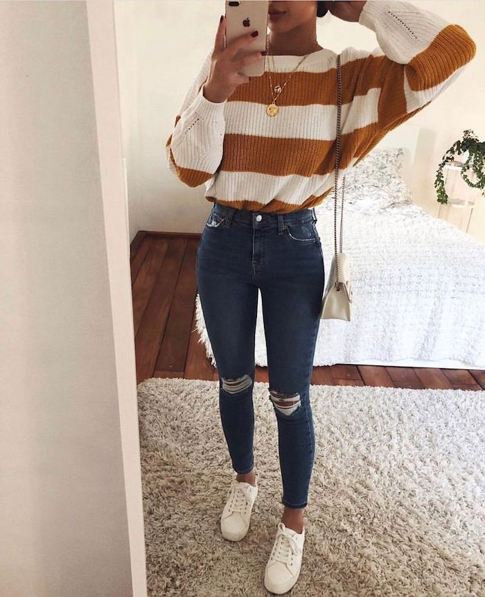 white sneakers, cute back to school outfits, woman wearing jeans, white and brown striped sweater
