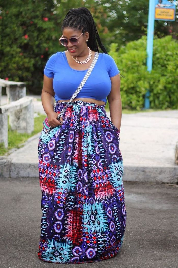 woman with black braided hair, wearing blue top and long skirt with colorful print, easter outfit