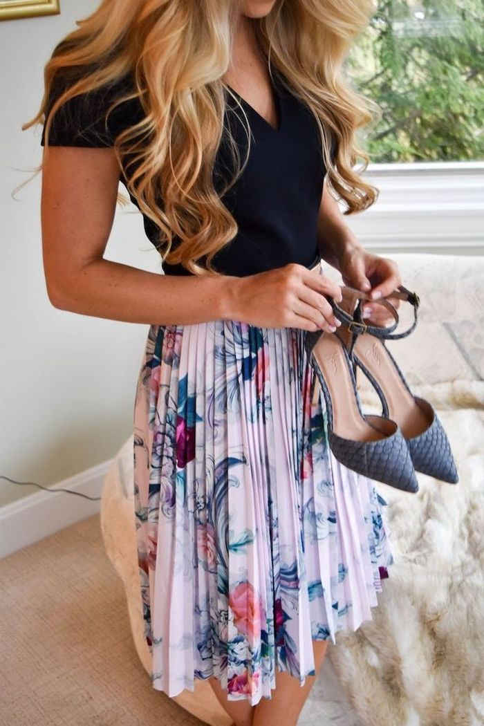 blonde woman wearing black top, pleated skirt with floral print, easter outfit, grey heels