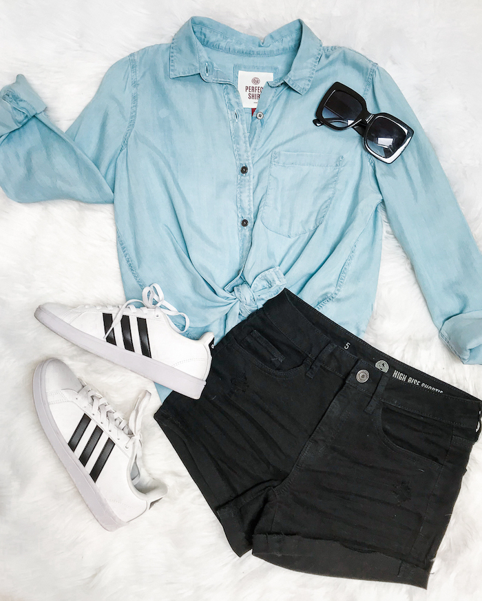 denim shirt and black shorts, white adidas superstar sneakers, laid out on a white surface, back to school outfits
