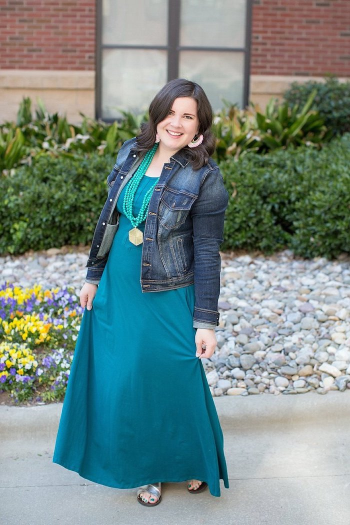 woma with short black hair, wearing long turquoise dress, easter outfit, denim jacket on top