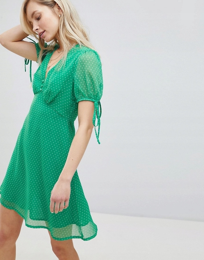 easter outfit, woman with blonde hair, wearing a flowy green dress with white dots, white background