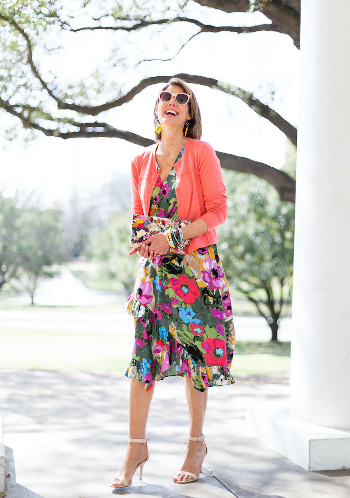 woman with short bob, wearing a dress with floral print, pink cardigan, easter outfits women, nude sandals