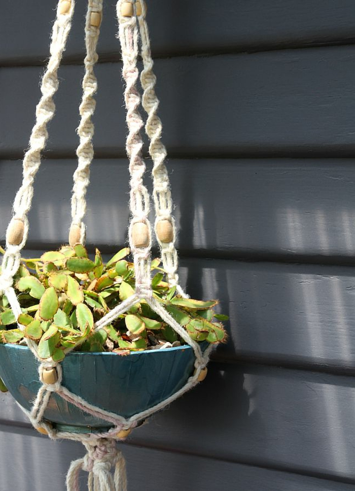 wooden beads tied into white macrame, blue pot hanging from the ceiling, macrame plant hanger patterns