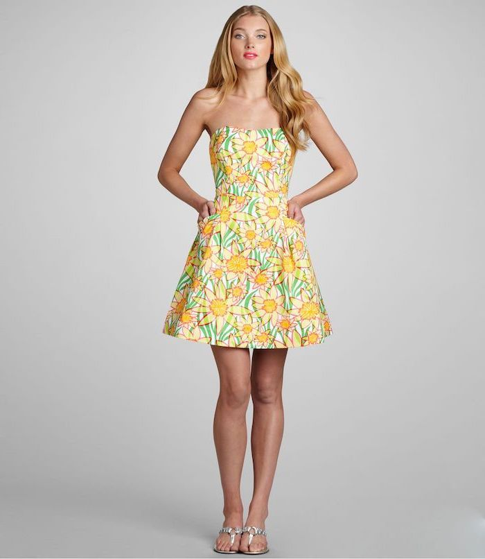 elsa hosk with blonde wavy hair, easter outfits women, wearing a dress with bare shoulders, sunflowers print