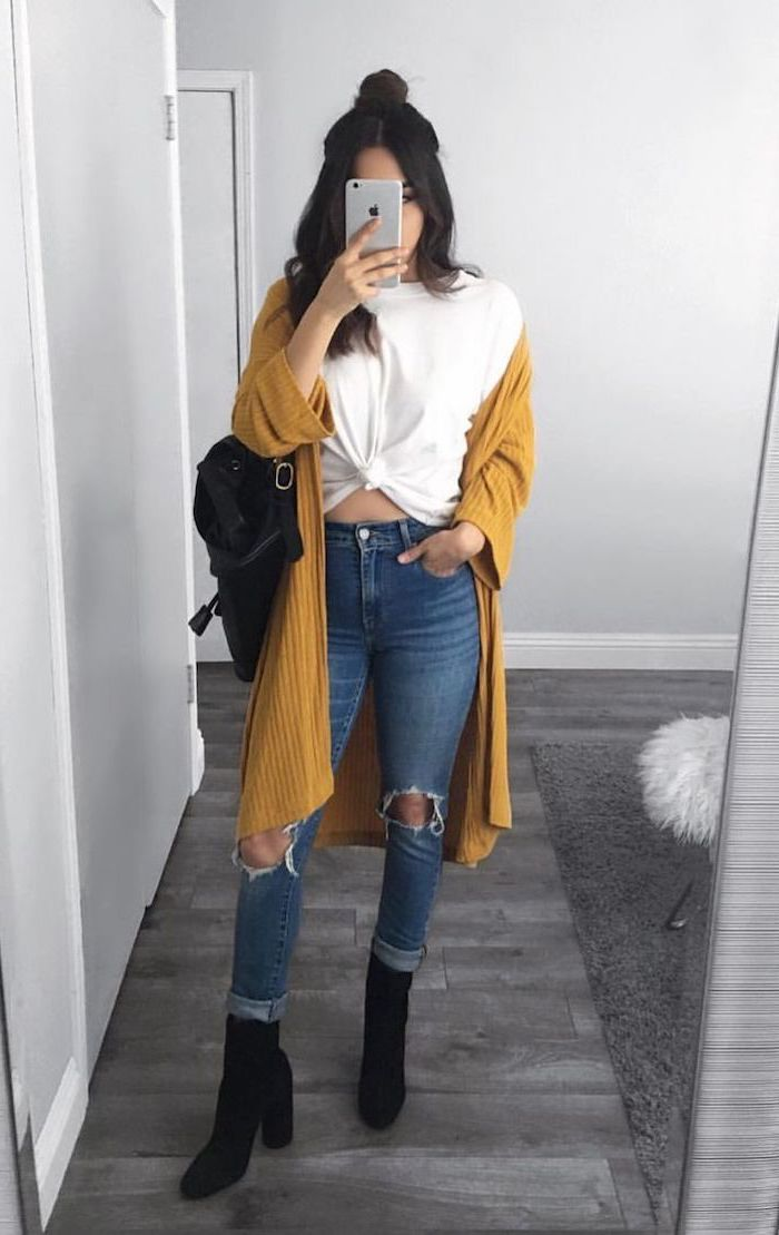 brunette woman wearing jeans and white t shirt, yellow mustard cardigan, cute comfy outfits, black velvet boots