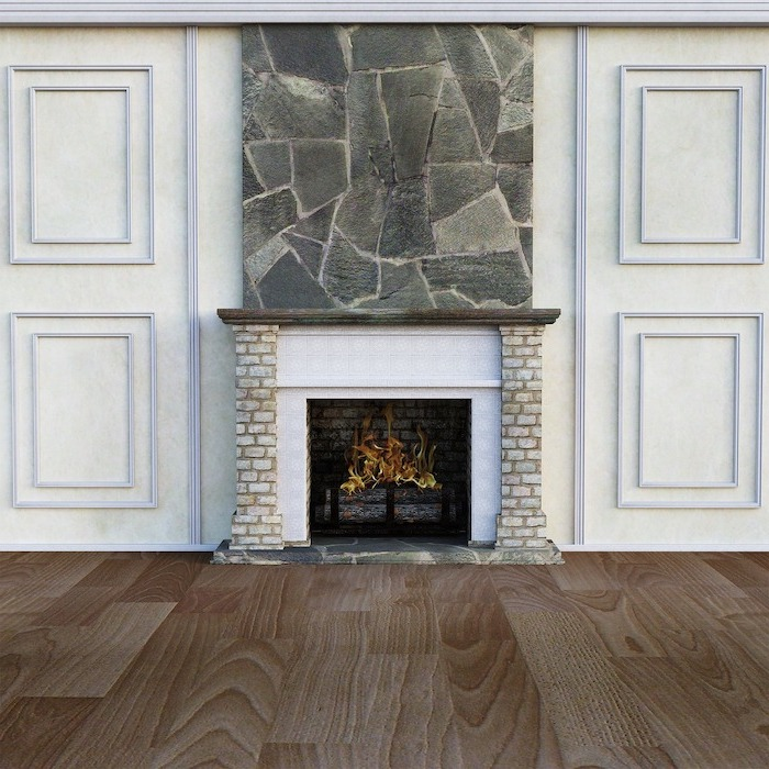 fireplace with fire burning inside, laminate flooring, wooden floor and white walls