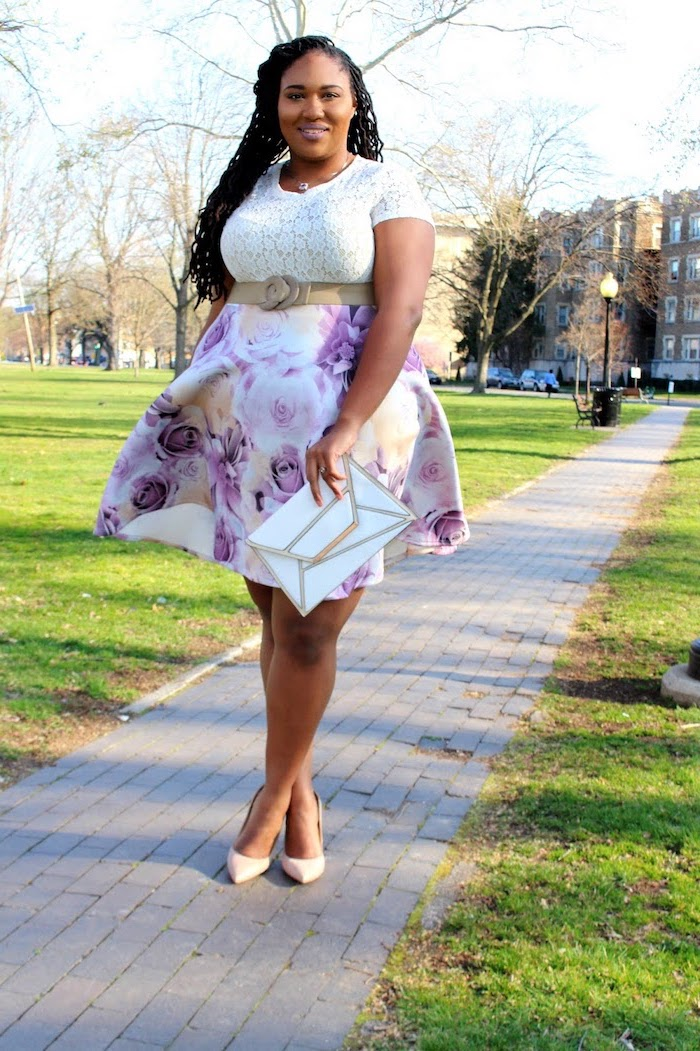 woman with black braided hair, wearing a white lace top, skirt with floral print, plus size easter dresses