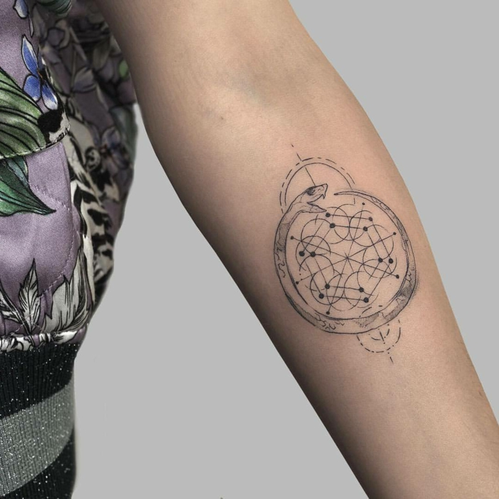 forearm tattoo, white background, geometrical design, snake eating itself