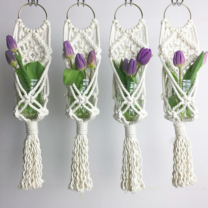 four glass jars with purple tulips inside, hanging from the ceiling, macrame plant hanger tutorials, white background