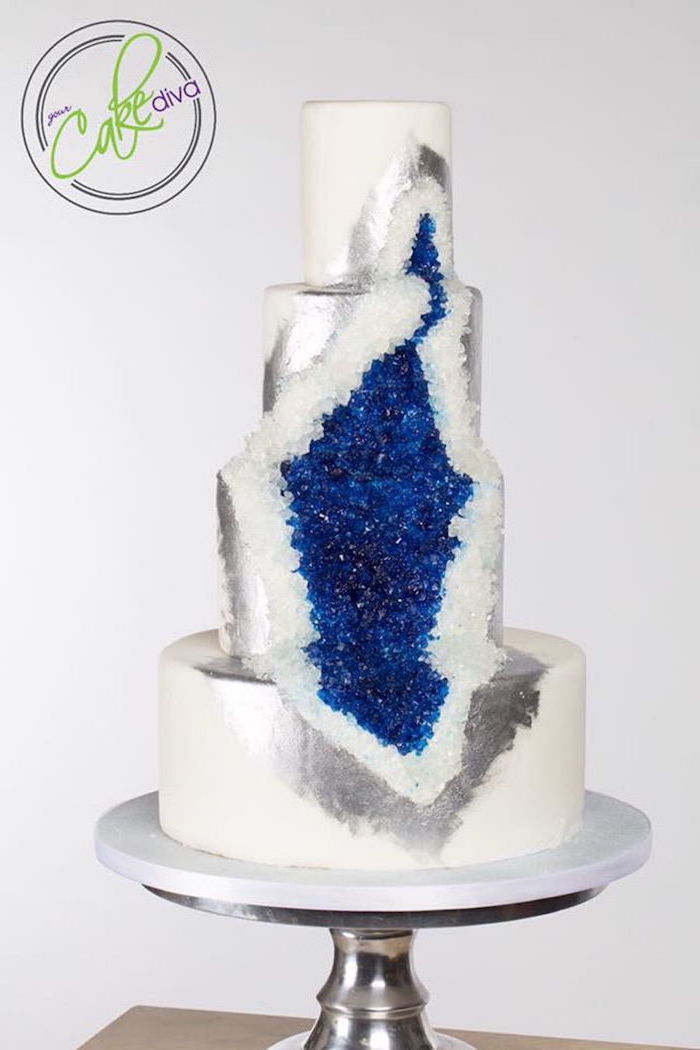 four tier cake, covered with white fondant, decorated with white and blue rock candy, how to make a geode cake, silver paint