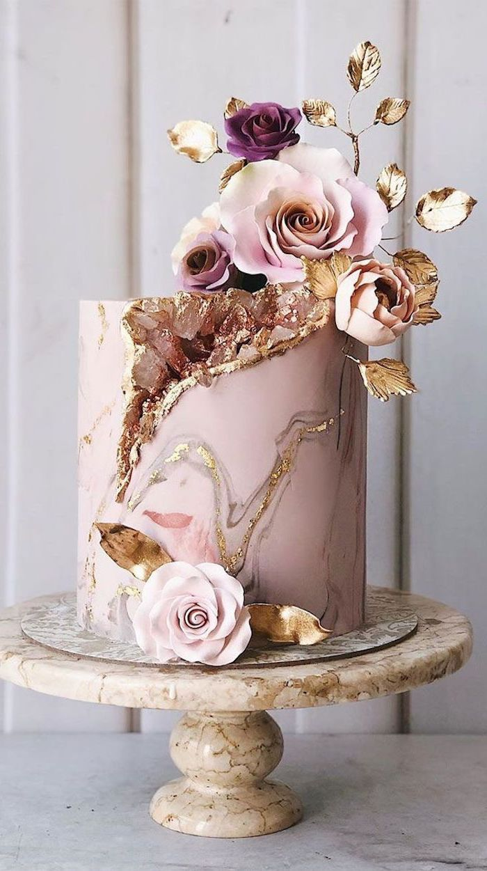 one tier cake, covered with pink and gold marble fondant, rock candy cake, decorated with pink rock candy and flowers