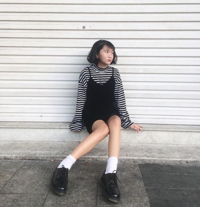girl sitting on a step, wearing black dress, white and black blouse underneath, fall outfits for girls, black shoes with white socks