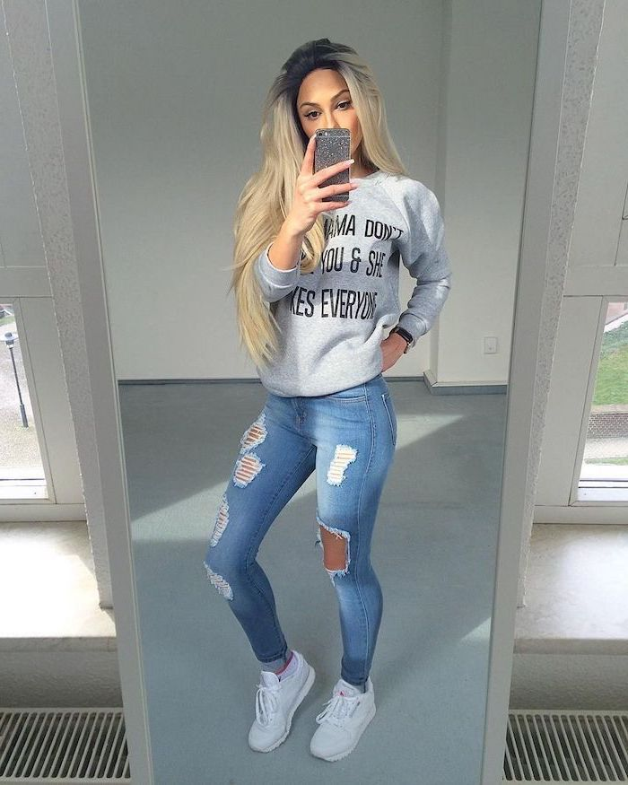 blonde girl wearing jeans, grey sweatshirt, white sneakers, first day of school outfits, posing in front of a mirror