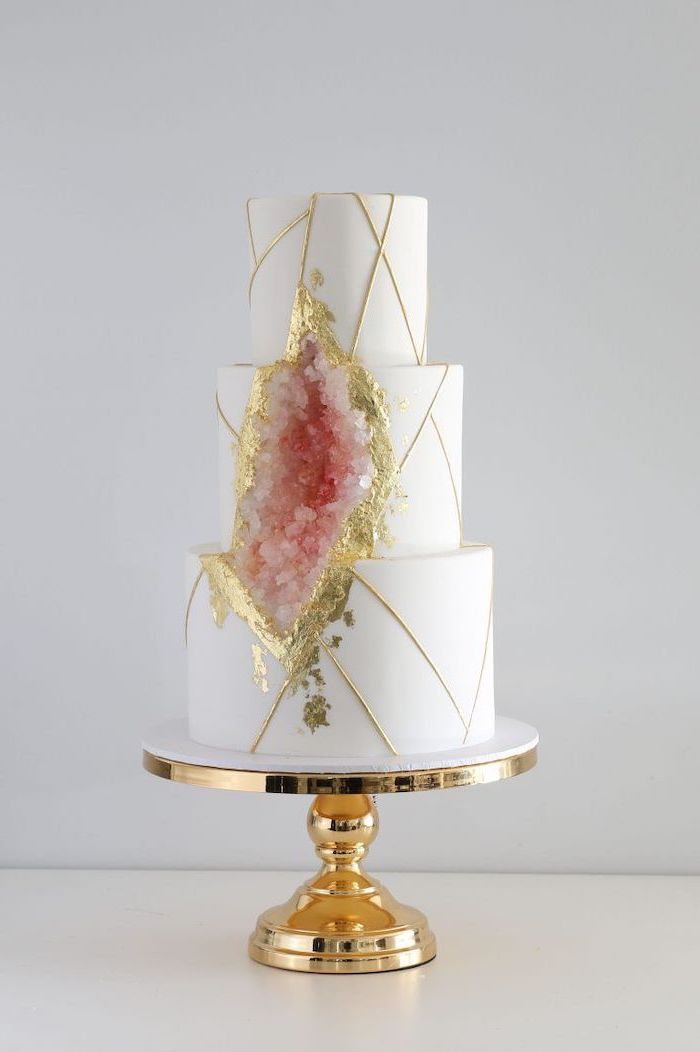 three tier cake, covered with white fondant, rock candy cake, decorated with white and pink rock candy