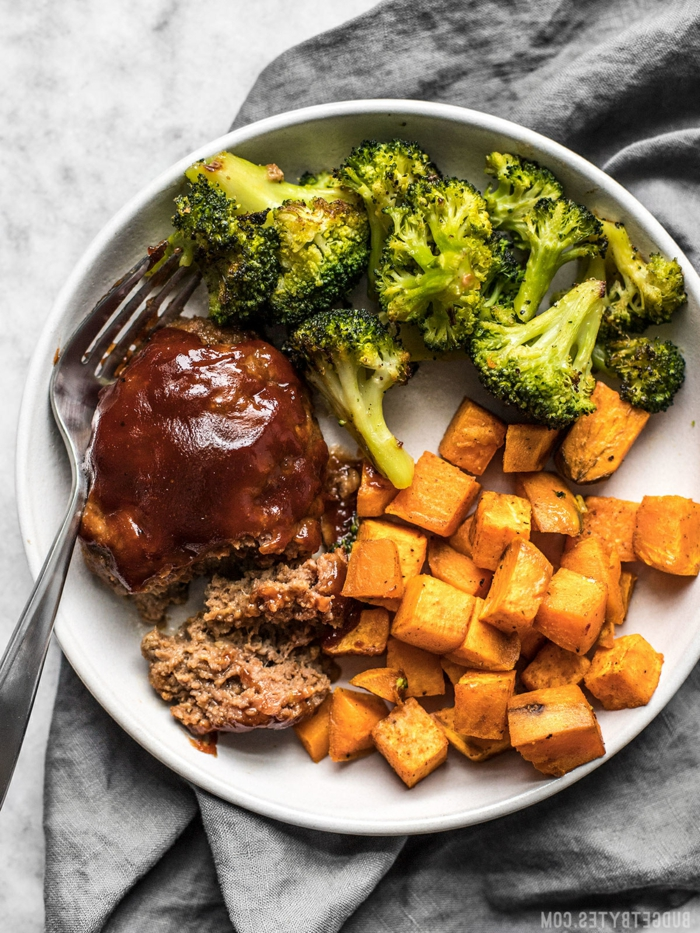 stealk with broccoli and sweet potatoes, quick and easy dinner recipes, placed on white plate with fork on the side