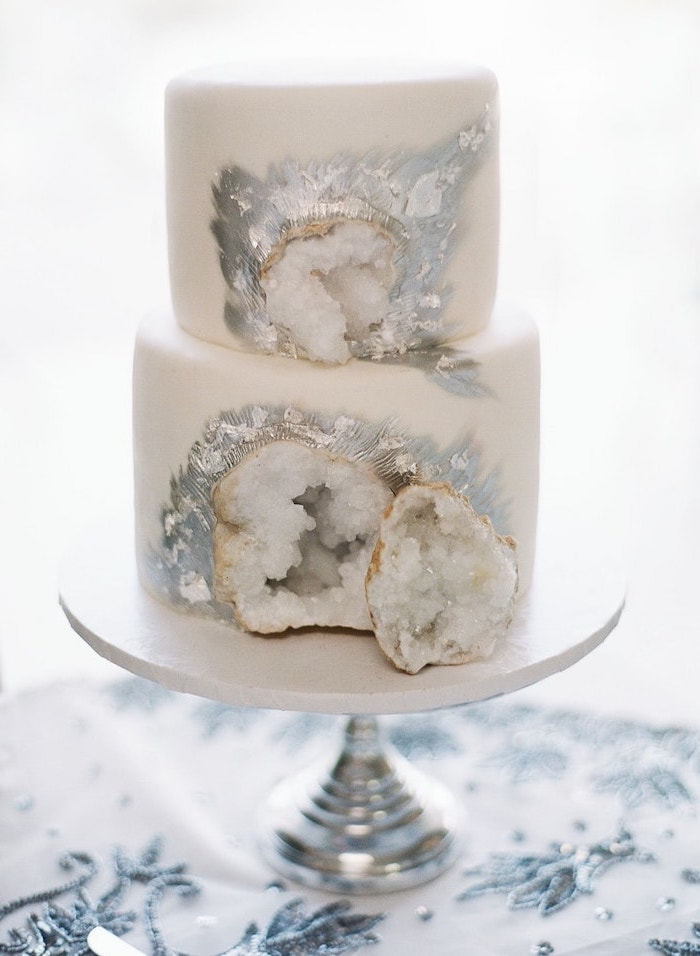 two tier cake, covered with white fondant, amethyst cake, decorated with white rock candy and silver paint