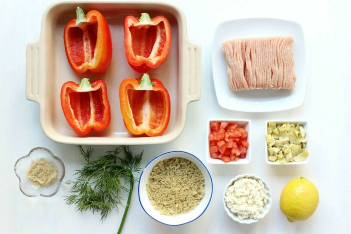 red bell peppers cut in half, bowls and plates with different ingredients, easy weeknight dinners, stuffed bell peppers