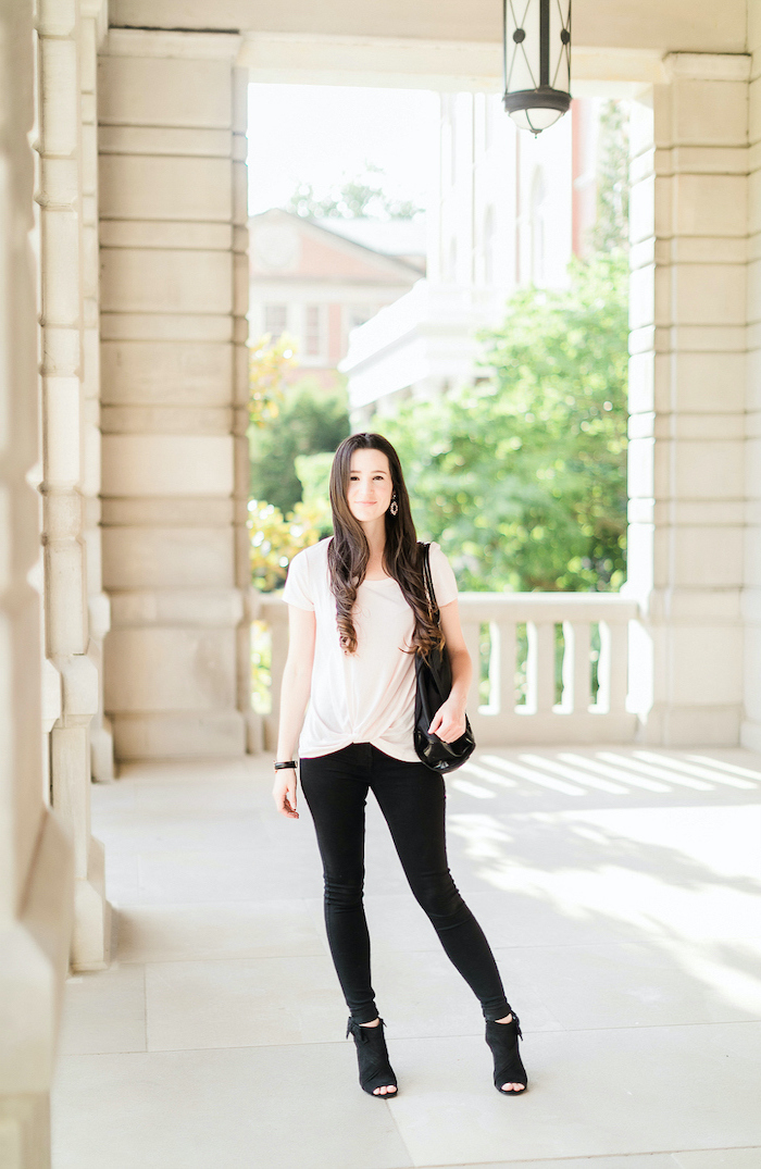 brunette girl wearing black trousers, white t shirt, black open toes boots, cute outfits for kids
