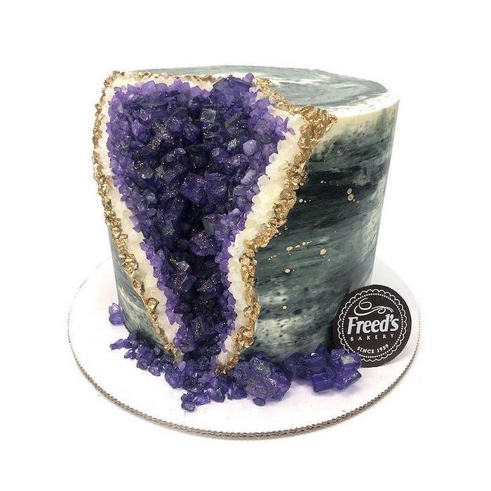 one tier cake, covered with grey and white marble fondant, decorated with purple rock candy, geode cake recipe