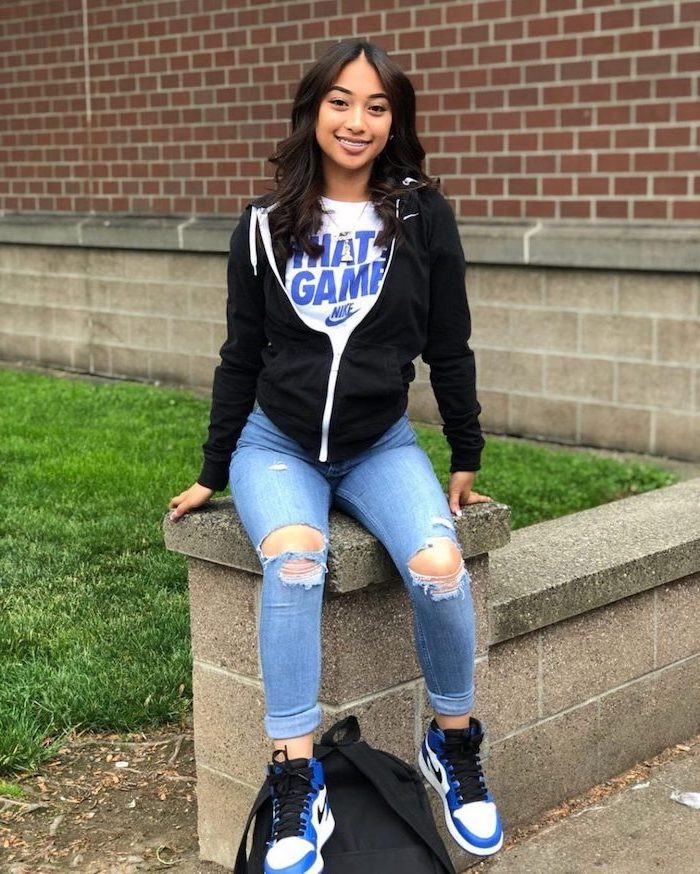 girl wearing jeans, white nike t shirt, black nike hoodie, middle school outfits, white blue and black nike air sneakers